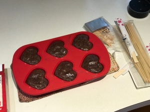 Heart shaped brownies in red silicone pan